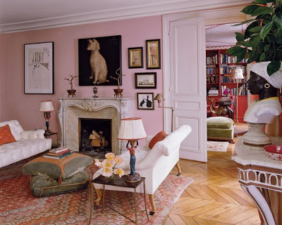 lisa fine paris living room with pink walls, white fireplace and chevron floor via belle vivir blog