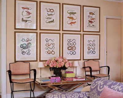 lisa fine paris living room with a gallery wall and pink walls via belle vivir blog
