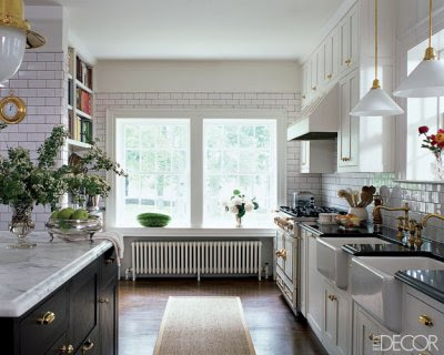 white kitchen with floor to ceiling subway tiles on the walls via belle vivir