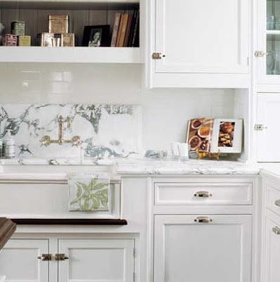 kitchen with marble back splash and white cabinets