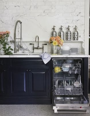 kitchen with mosaic floor and floor to ceiling tiles via belle vivir blog
