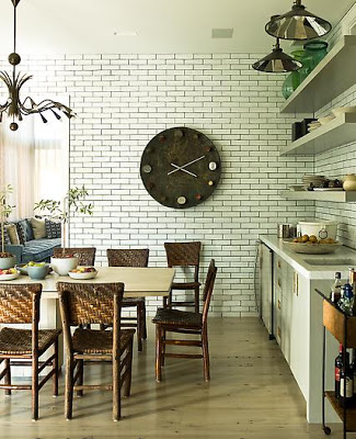 kitchen with floor to ceiling subway tiles and caned chairs