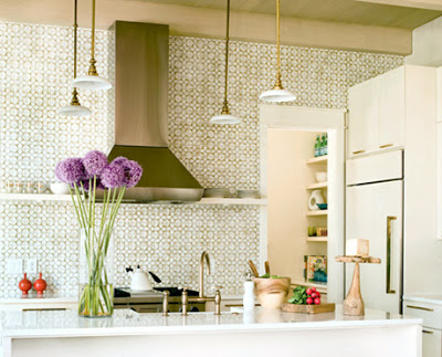 open kitchen with mosaic tiles from floor to ceiling