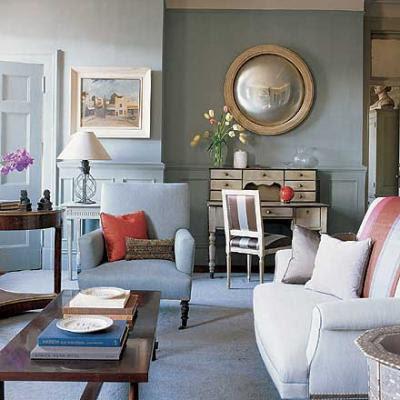 convex mirror in a blue living room via belle vivir
