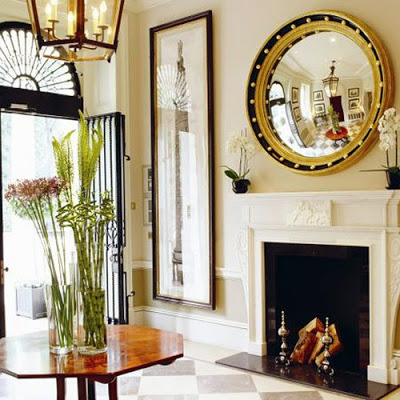 convex mirror over fireplace and checkered floor room