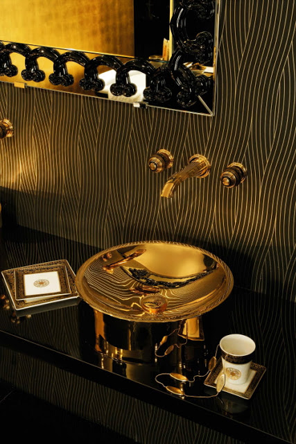 black bathroom with brass decor idea via belle vivir blog
