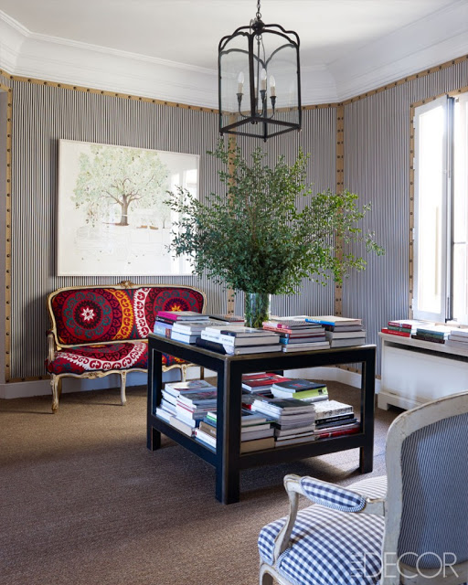 Studded Nailhead upholstered walls Carolina Herrera Baez's home via belle vivir blog