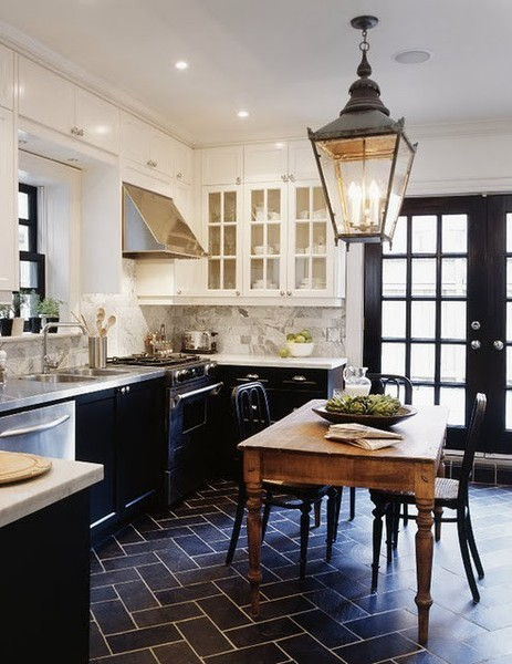 kitchens with black lower cabinets and white upper cabinets