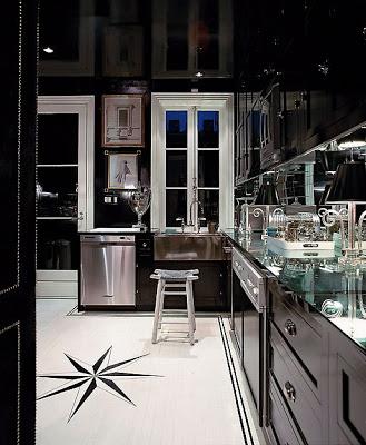 black kitchens via belle vivir blog, kitchens with black cabinets and mirror back splash