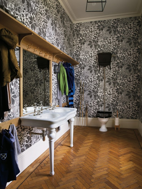 Ilse Crawford bathroom with herringbone floor design