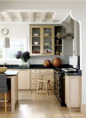 light cabinet with black counter tops via belle vivir blog
