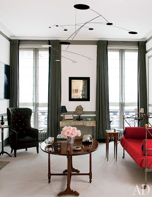 Tino Zervudachi's Paris Home via belle vivir blog, tino zervudachi's paris home living room with iron daybed with red upholster