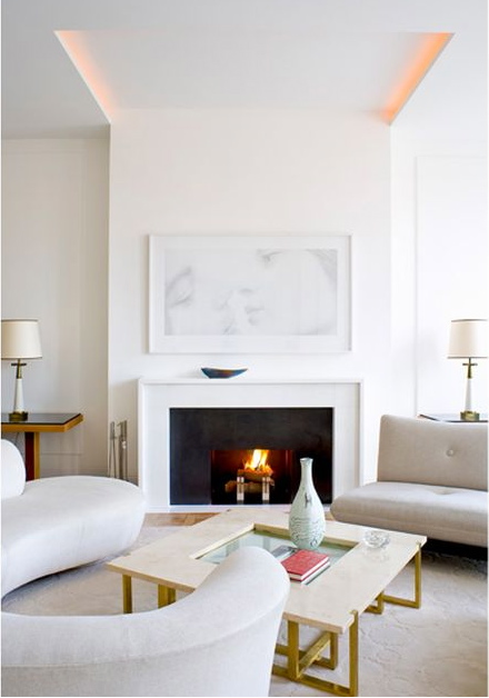 white living room with white fireplace