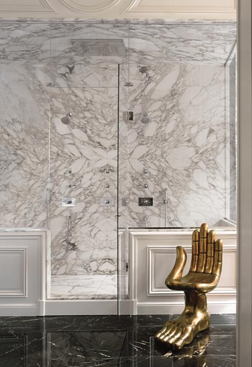 White marble Bathroom with Brass Fixture, lenny kravitz bathroom with pedro friedeberg chair