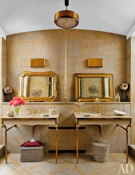 Architectural Digest bathroom with double sink with brass legs