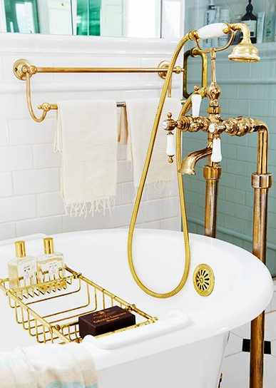 bathroom with white swbway tiles and brass