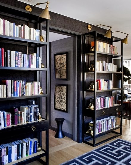 Black wall painted rooms, black walls with black bookcases and seagrass wallpaper