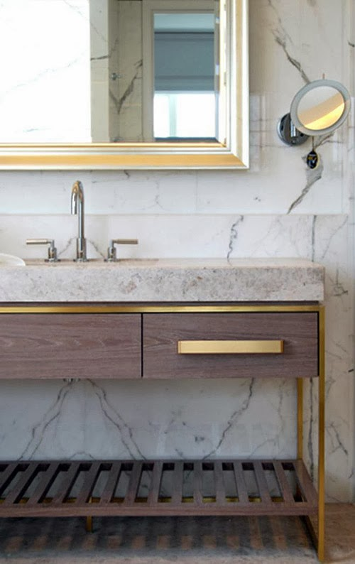 wood, marble and brass in a bathroom
