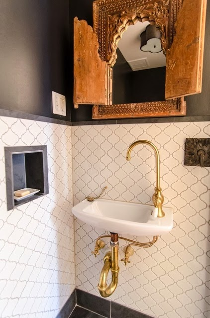 white tiles and brass sink