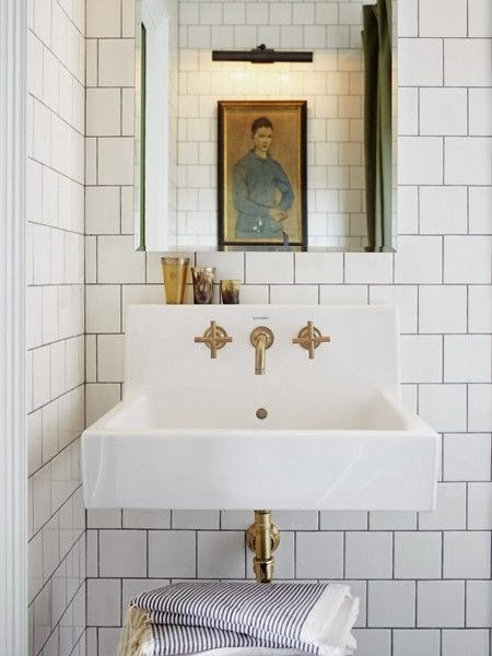 White Marble Bathroom With Brass Fixture, House And Home Bathroom With  Small Sink And Brass
