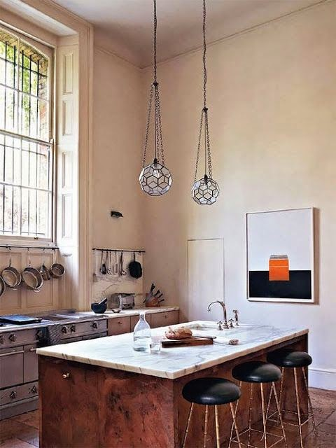 ways to display pots and pans in the kitchen via belle vivir blog