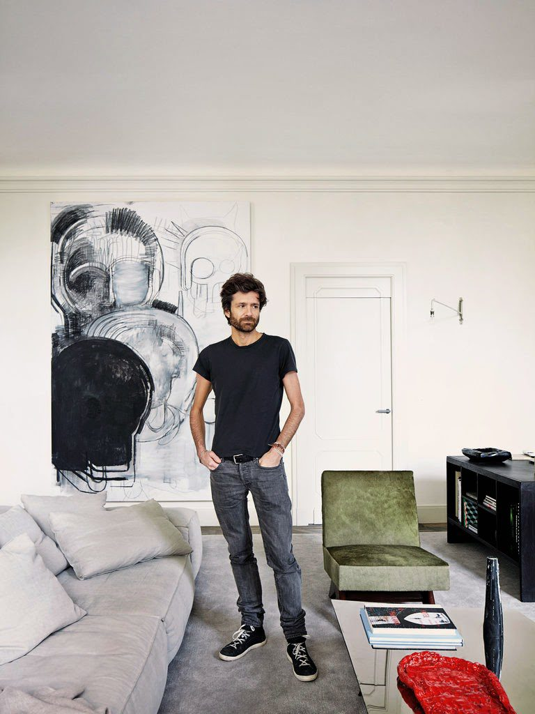 Joseph Dirand standing in his living room at home