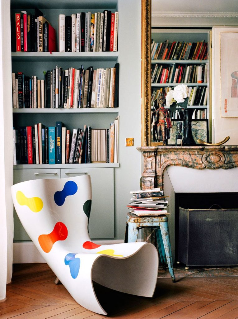 Giambattista Vali Apartment in Paris fire place next to funky chair