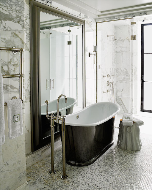 color black in Interiors, barble bathroom with black tub the use of black in interiors via belle vivir blog
