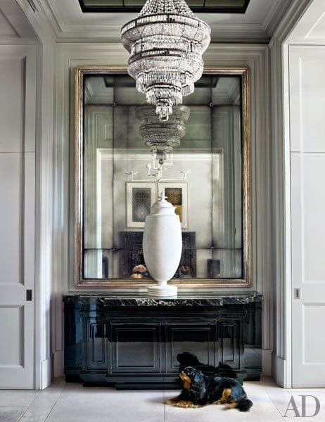 color black in Interiors, entryway with antique mirror and chandelier the use of black in interiors via belle vivir blog