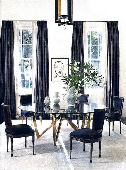 color black in Interiors, black chairs with brass table the use of black in interiors via belle vivir blog
