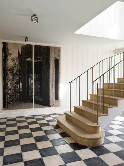 entryway with floating stairs and checkered black and white floor