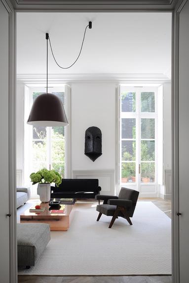 joseph dirand living room with black chair the use of black in interiors via belle vivir blog