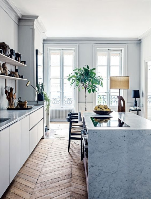 kitchen with white marble countertop and chevron floor