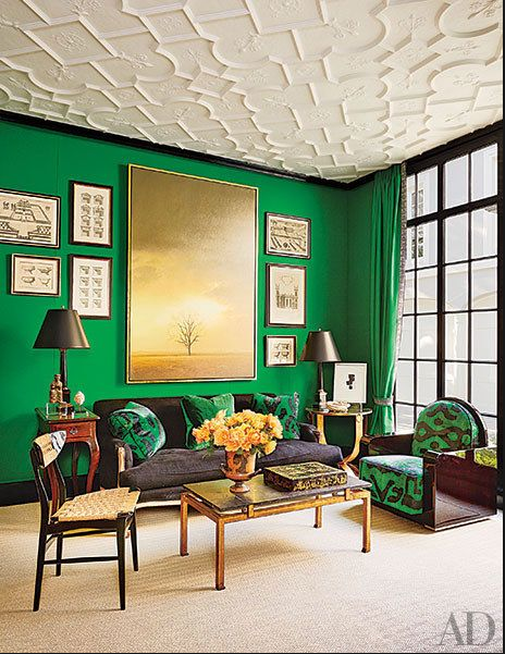 green living room with black sofa