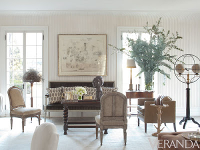 white living room with classic furniture upholstered in different shades of browns.