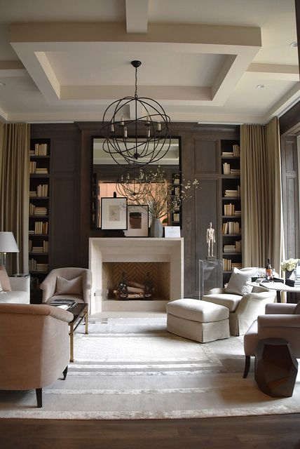 transitional interior design, coffered ceiling, brown walls and bookcases and beige and light pink upholstered furniture