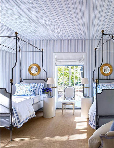 blue and white striped bedroom with two canopy iron bed via belle vivir blog