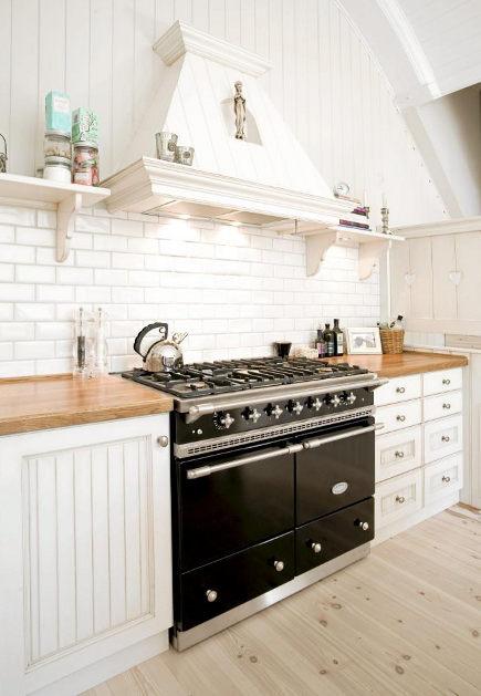 White kitchen with LaCanche black range/stove