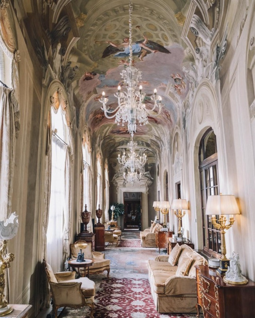ornate hallway with painted ceiling and antique furniture