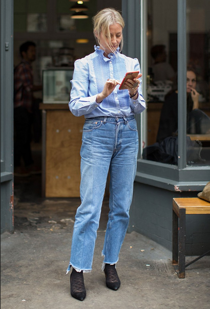 Nicole Richie wearing jeans with blue top