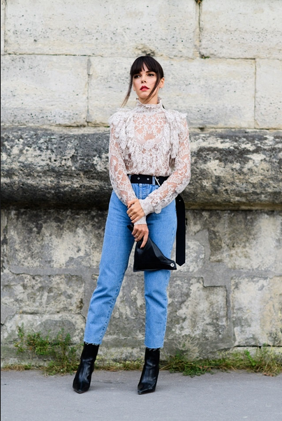 girls wearing lace white top and jeans and black booties
