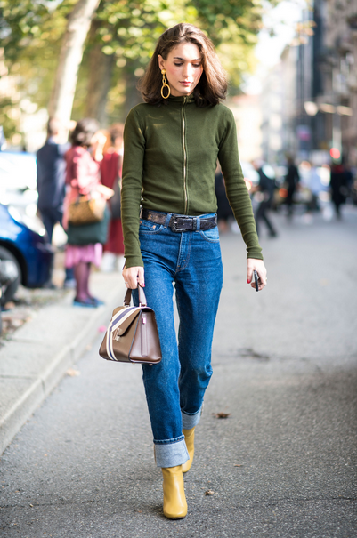 girl wearing jeans, yellow booties and green sweater