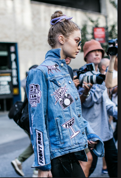 Gigi Hadid wearing a jeans jacket with appliques