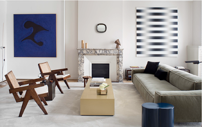 transitional interior design with Pierre Jeanneret chairs, modern art and clean lines sofa