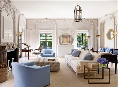 living room with ornate walls lean lined furniture in blue and beige
