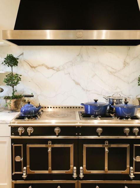 La corneu black stove with chrome trim and white marble backsplash kitchens with black stove