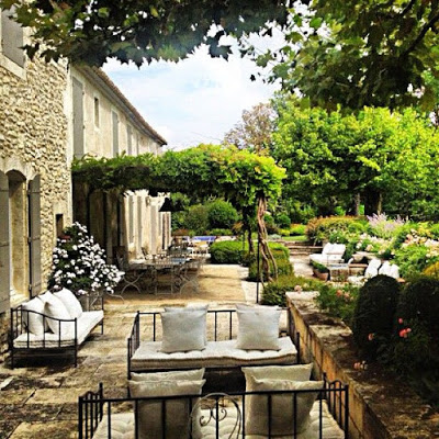 Provencal Garden corridot like garden with iron furniture with french mattress and pillows
