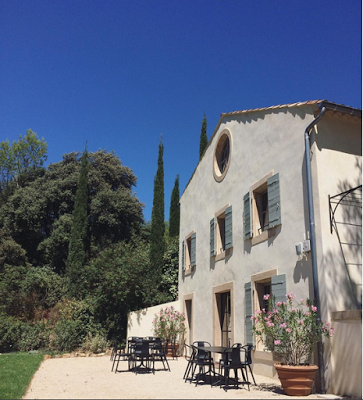 Provencal Gardens Luberon Region garden with gravel and black iron chairs