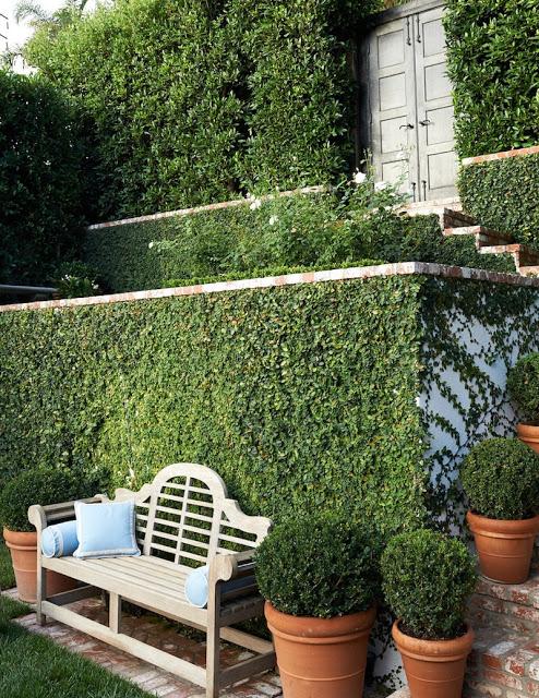 Mark D Sikes Outdoor patio design with lutyens bench via belle vivir blog