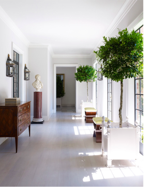 Bruce Budd Design white gallery with topiaries
